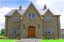 Donegal Sandstone with Brush Hammered Sandstone Window and Door Surrounds