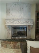 White Pinon Cantera Carved Fireplaces