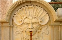 Atlantide Limestone Carved Wall Mounted Fountain, Giallo Dorato Yellow Limestone Wall Mounted Fountains