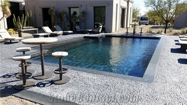 Blue Stone Coping And Black Pebble Tile Swimming Pool