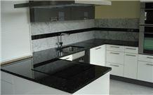 Black Galaxy Granite Countertop and Carrara White Marble Baclsplash