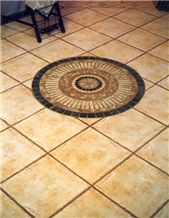 Terracotta Floor Tiles and Mosaic Medallion