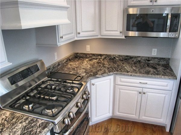 White Kitchen Cabinets And Black And Brown Marble Countertops