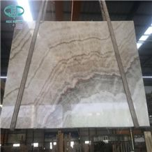 Nyx, White Onyx Gold Line,Gold Line Onyx,Yellow Wooden Onyx,Sef Onyx, Polished Yellow Onyx Slabs Price: Unlisted Xiamen Essency Import and Export Co,.Ltd China-Fujian-Nan