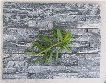 Black with White Point Cultured Stone