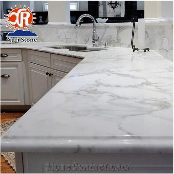Add Unexpected Elegance with a Marble or Granite Kitchen ...