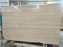 Polished Travertino Silver Slab Wall Installation