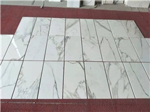 /products-717384/calacatta-oro-white-marble-thin-tile